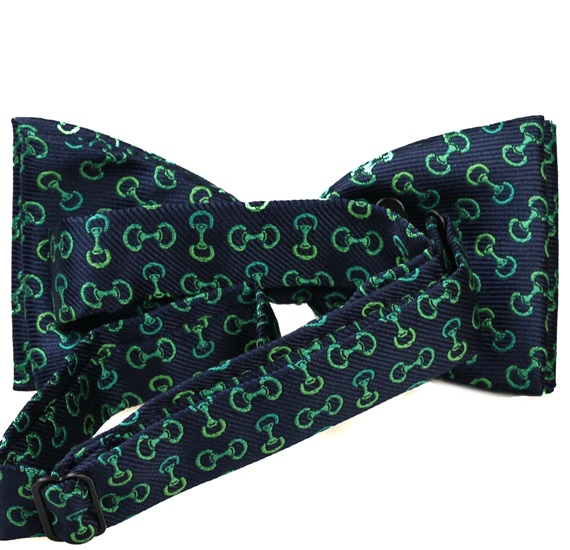 Blue bow tie with green designs riding reverse