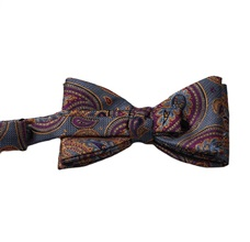 Blue bow tie with garnet and ocher paisley reverse